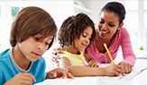 Mom and two children doing schoolwork